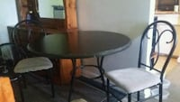 round brown wooden table with two chairs Guelph, N1H 7K7