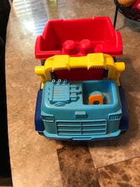 Blue, yellow, and red dump truck toy Clifton, 07013