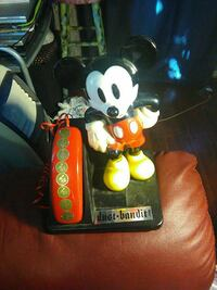 red and black Mickey Mouse home phone