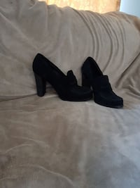 pair of black chunky heeled shoes