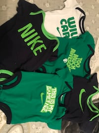Baby's three assorted onesies Olive Branch, 38654
