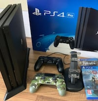 Playstation 4 pro 2 controllers charger stand and 2 games