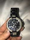 round black and silver diamond embellished case Guess chronograph watch