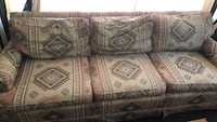 Aztec pattern couch, down pillows and solid wood frame