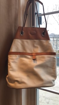Women's brown and black leather tote bag