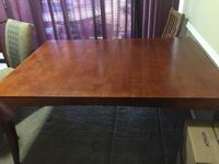 rectangular brown wooden dining table 32 km