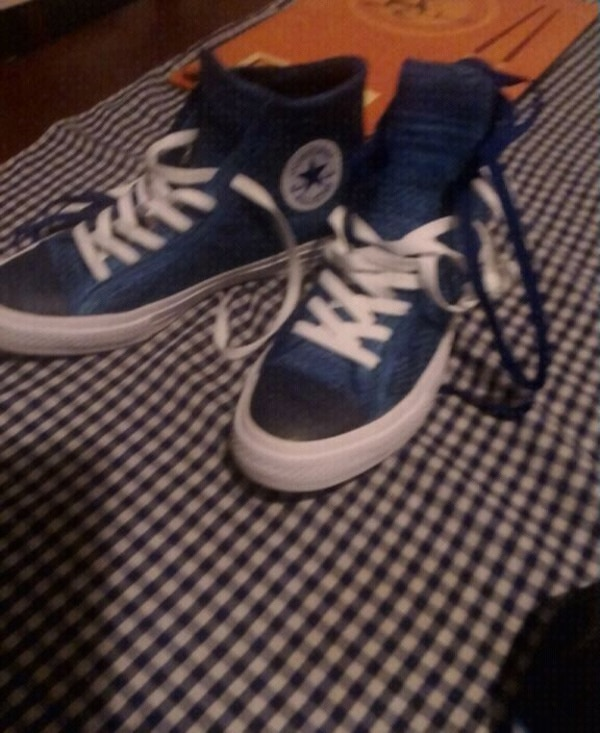 pair of blue-and-white Nike sneakers