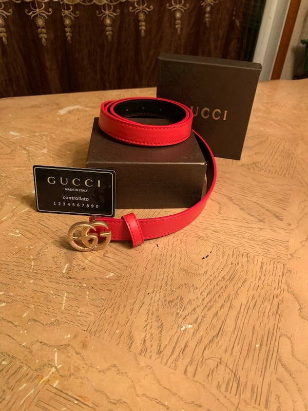 Red Gucci woman belt with gold buckle 720374a6-4103-4e6c-9435-84234020b809