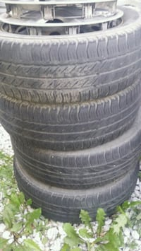 four black rubber car tires