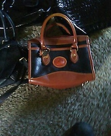 brown and black Dooney and Bourke leather handbag