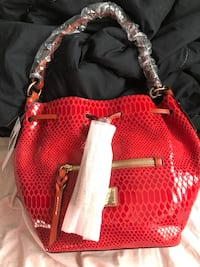 Red crocodile-skin bucket Dooney and Bourke bag