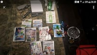 Wii console with controllers and game c