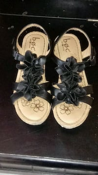 pair of brown-and-black leather sandals