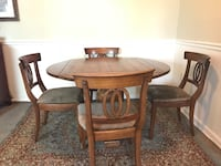 Round brown wooden table with four chairs dining set 54 km