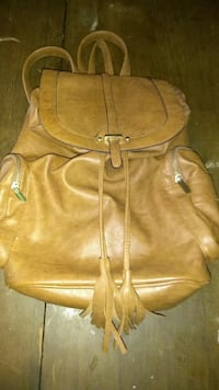 brown leather saddle backpack