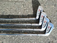 four gray-and-red floral metal golf clubs Richmond, V7A 2E5