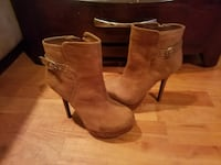 Women's pair of brown suede heeled boots