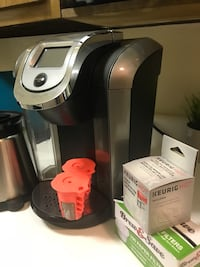 black and gray Keurig coffeemaker 2.0 with extra carafe, 2 pods to use for your own coffee as well as brand new water filter and a box of coffee filters. Only used a few times New York, 11230