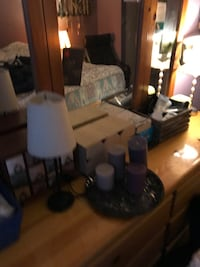 Custom made bed frame, side table, dresser with mirror. Price negotiable