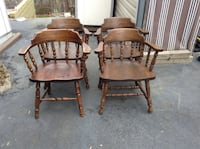Four brown wooden windsor armchairs