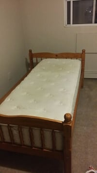 brown wooden bed frame with white mattress London, N5Z