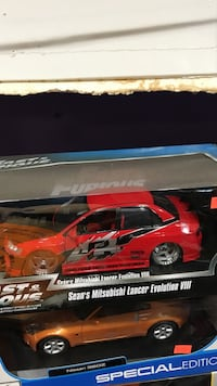 two red-and-brown Sean's Mitsubishi Lancer Evolution VIII boxes