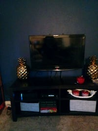 black flat screen TV with black wooden TV stand District Heights, 20747