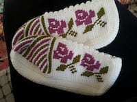 white pink and green floral crochet textile