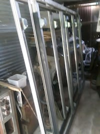 A 3 glass door and a 5 glass door  fraim and glass doors, for store.