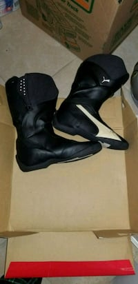 pair of black leather boots motorcyle puma boots  Arlington, 22206