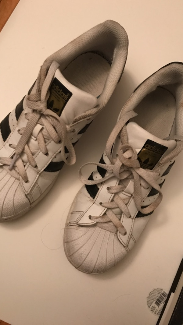 white-and-black Adidas Superstar's