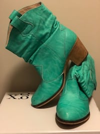 pair of green leather boots Laurel