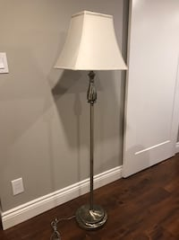 Antique Bronze finish floor lamp with ivory shade