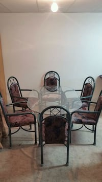 Glass top table , and six arm chairs ,  null