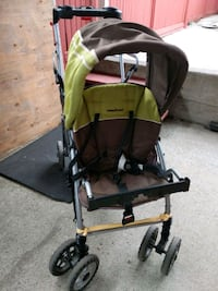 baby's black and green stroller