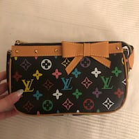 monogrammed brown Louis Vuitton leather wristlet Laval, H7X 3R8