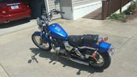 blue and black cruiser motorcycle 363 mi