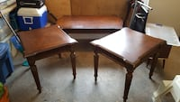 brown wooden coffee table an two end tables