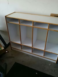 white and brown wooden shelf