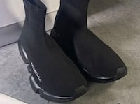 pair of black leather boots Toronto, M6M 2E5