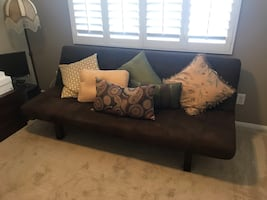 BROWN SUEDE CONVERTIBLE SOFA AND THROW PILLOWS. Great condition!