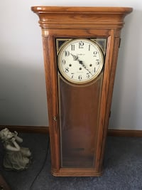 Howard Miller wall clock, missing pendulum and key which should cost around $90 to replace. Paid over $800. Decatur, 62521