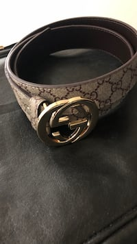 silver Gucci buckle with black leather belt Winnipeg, R2M 4J8