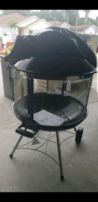 New fire pit with plastic cover 786 mi
