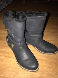 Pair of black leather 1-buckled mid-calf boots Las Vegas, 89103