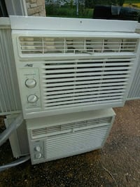 two white window-type air conditioners
