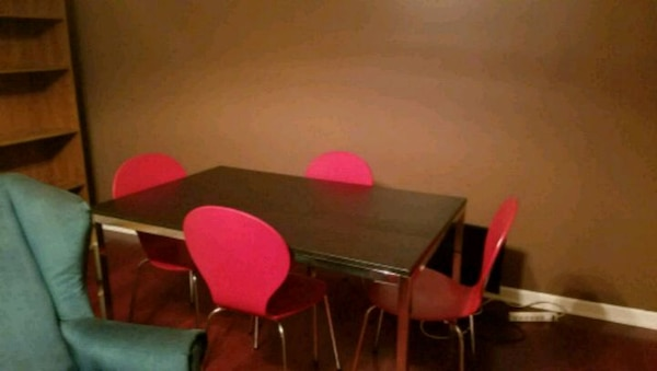 black and red dining table with 4 chairs