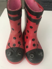 pair of pink-and-black rain boots Watchung