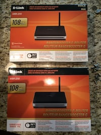 two black D-Link rangebooster g router boxes