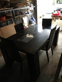 """Nice long black table with chairs """"old fashion."""""""